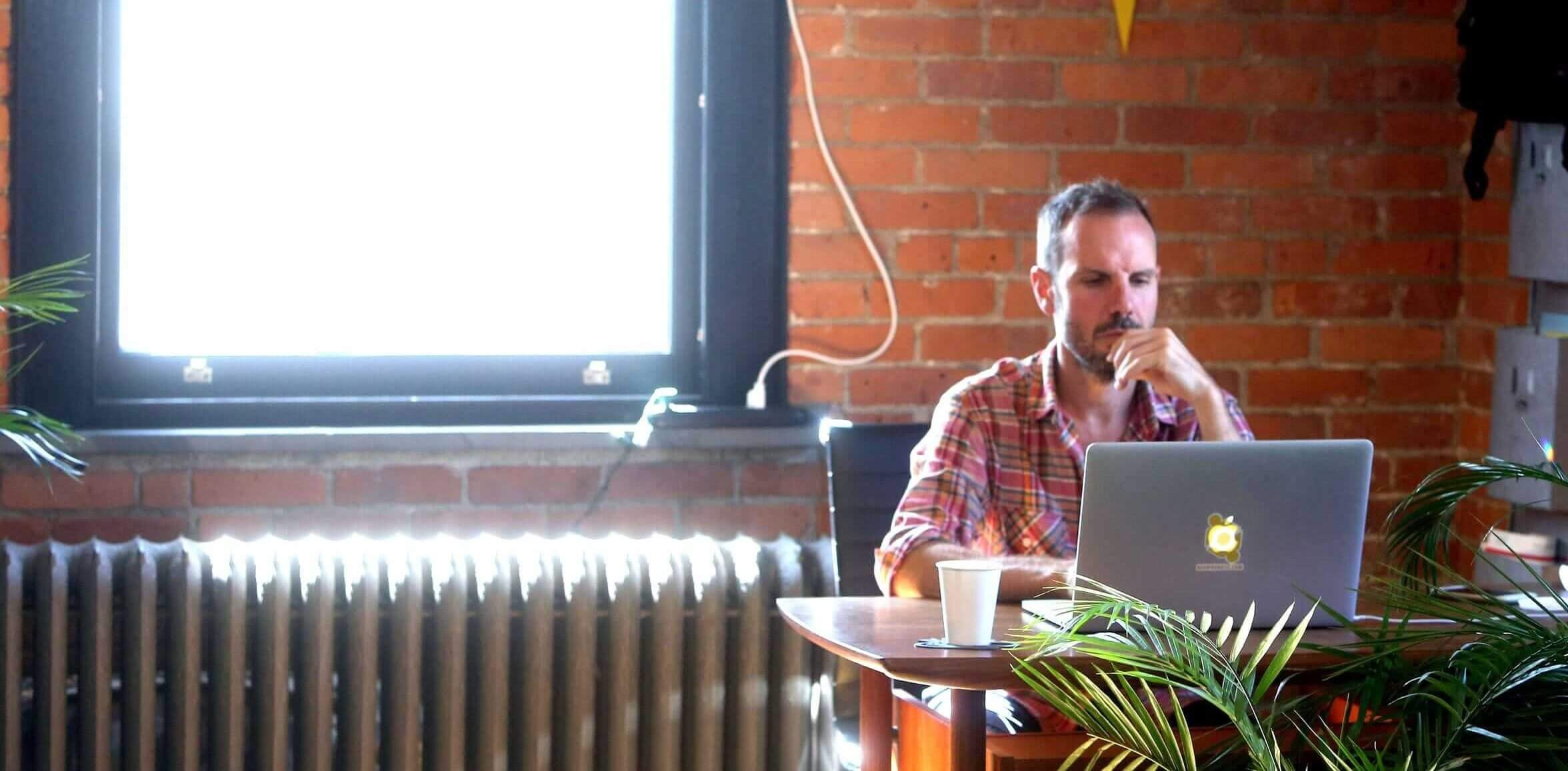 Scott Tillitt at his desk at BEAHIVE in Beacon